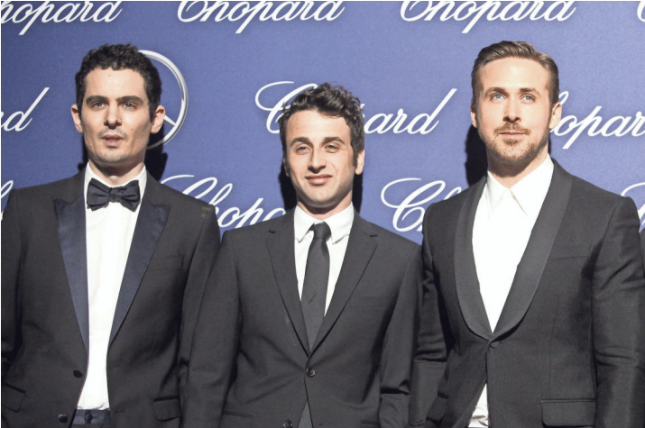 Damien Chazelle, Justin Hurwitz and Ryan Gosling pose for fans and photographers on the red carpet for the Palm Springs International Film Festival Gala on Monday.